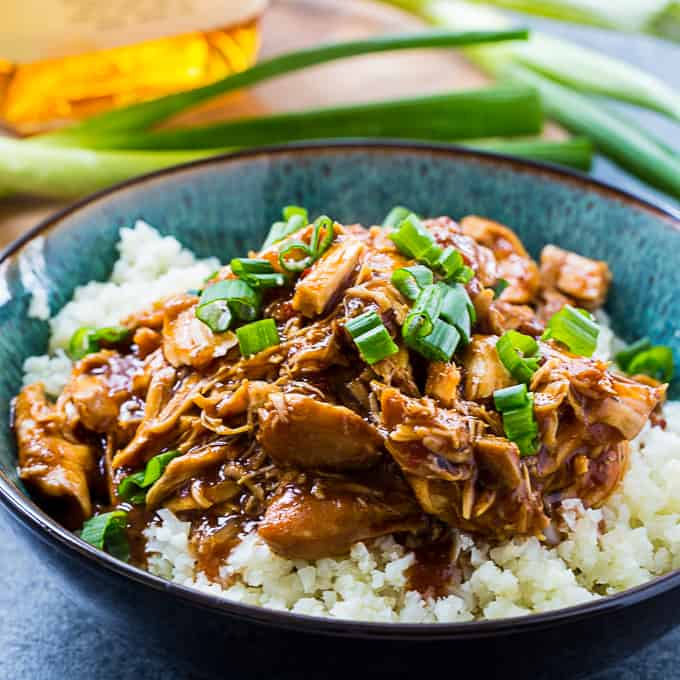Low Carb Bourbon Chicken served over caulirice