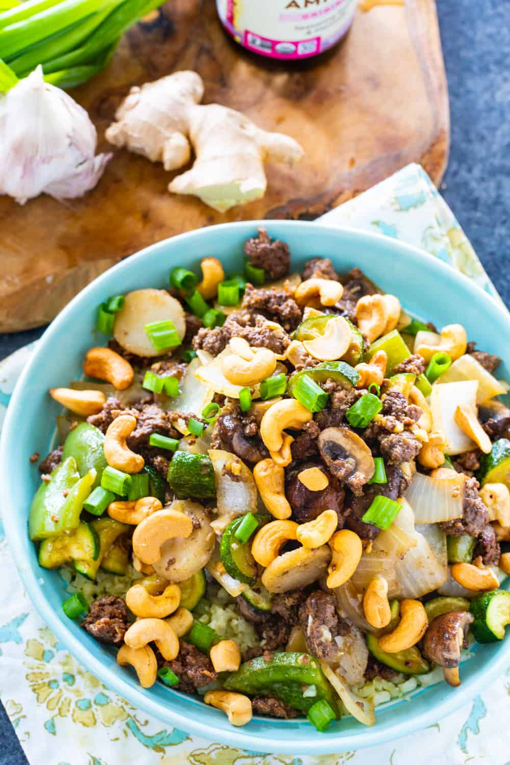 Overhead of Cashew Beef topped with cashews.