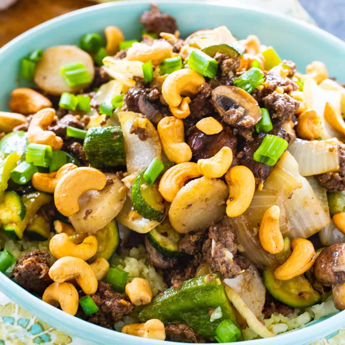 Keto Cashew Beef in a light blue bowl.