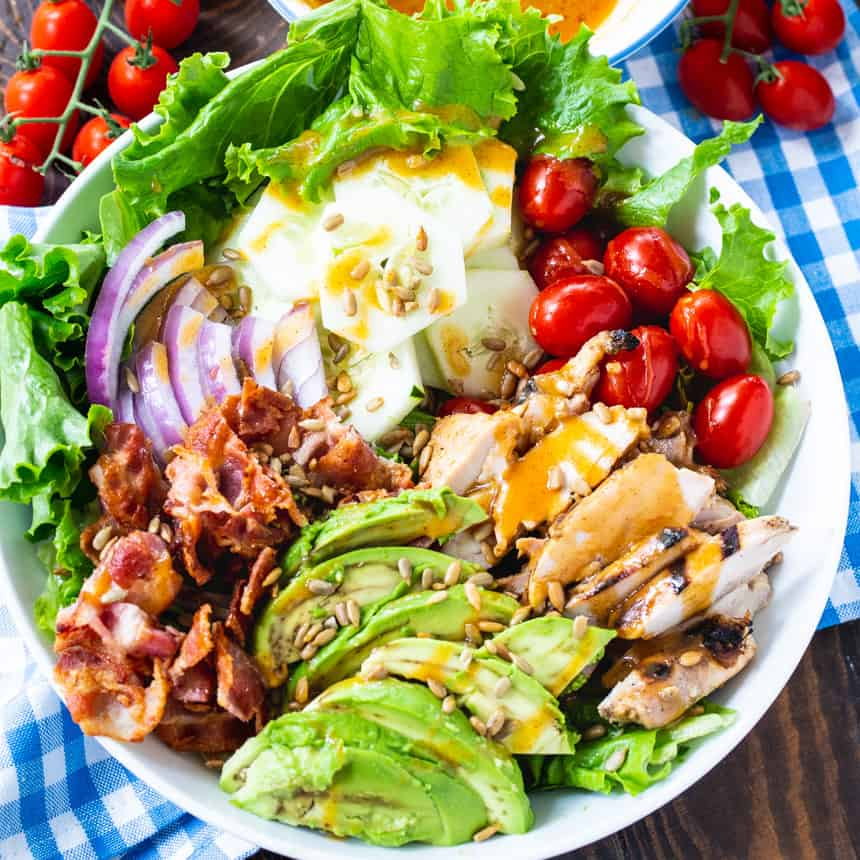 Salad wiith bacon, chicken, avocado and honey mustard vinaigrette