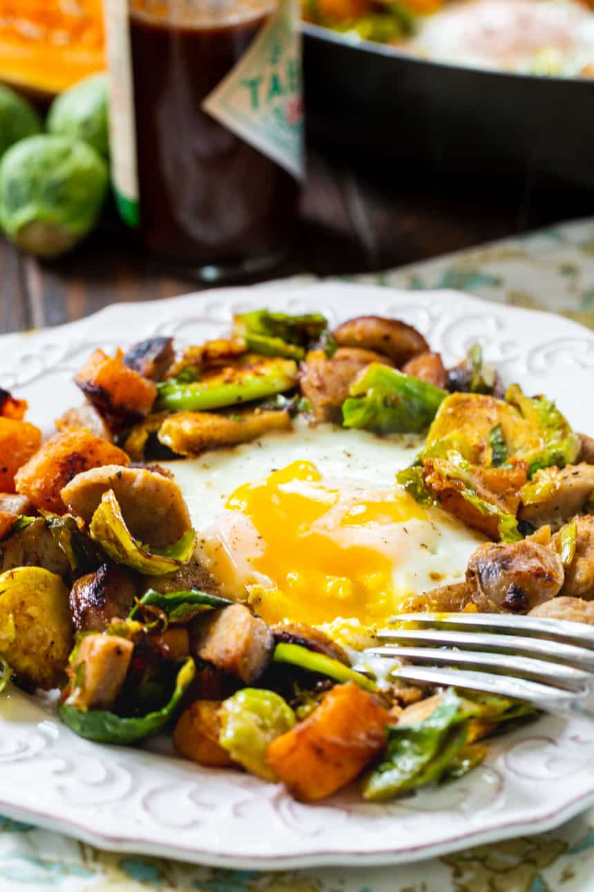 fried egg in the middle of brussels sprouts hash