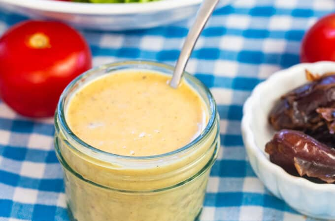 Dijon Date Dressing in a small Mason jar.