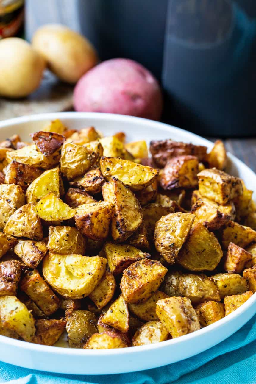 Air fryer Cajun Potatoes in a white bowl.