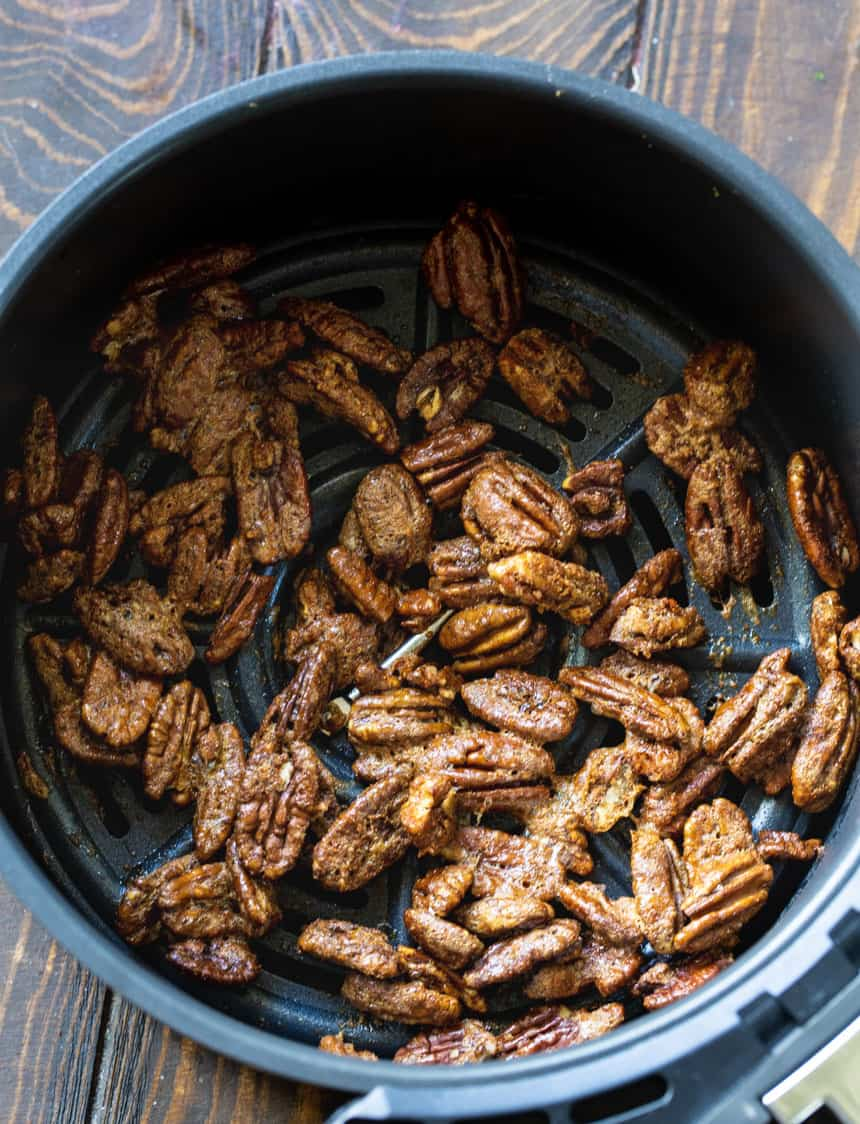 Pecans in air fryer basket.