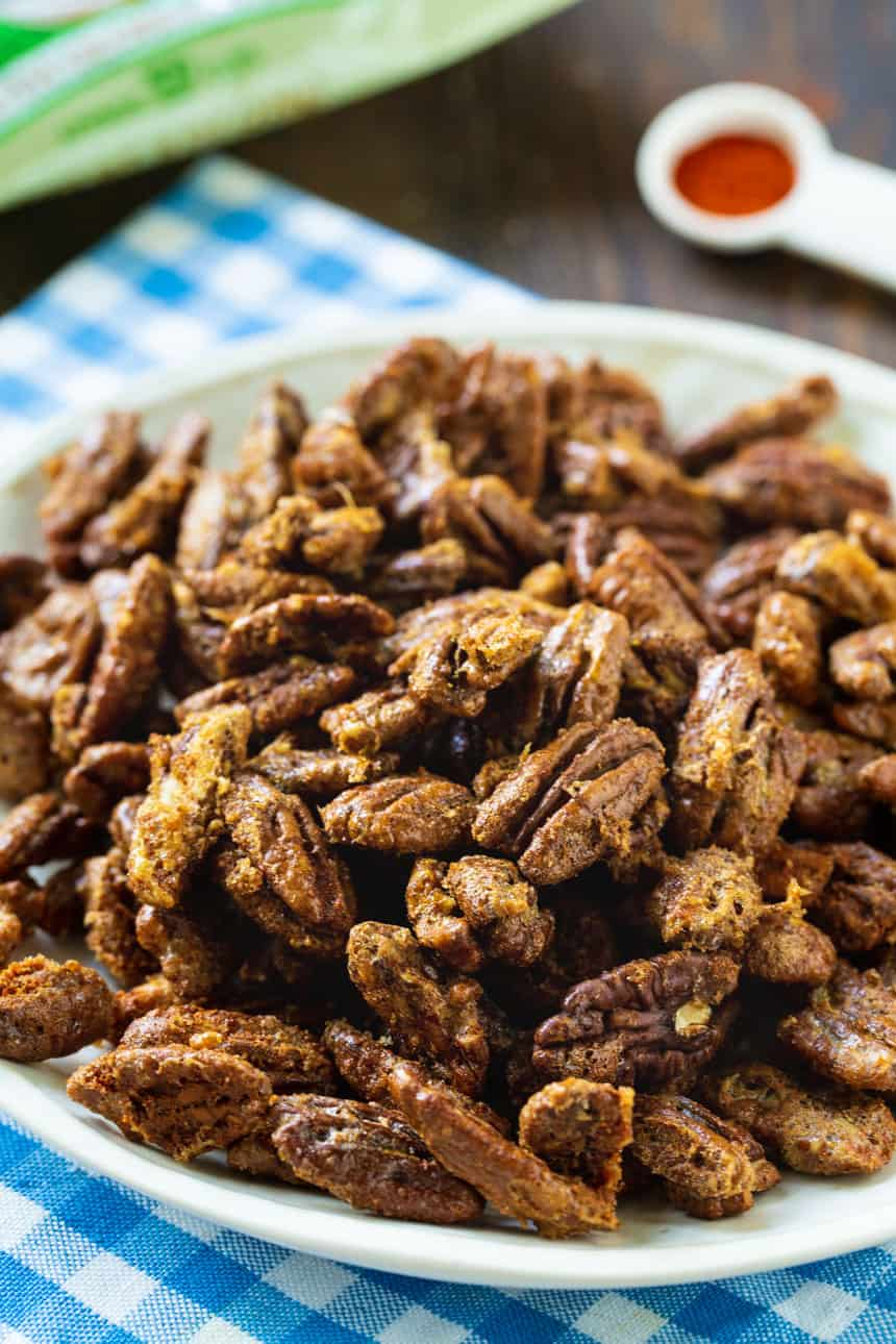 Sweet and Spicy Pecans on a white plate.