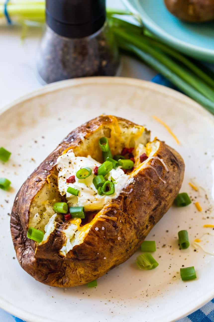 Air Fryer Baked Potatoes on a white plate.