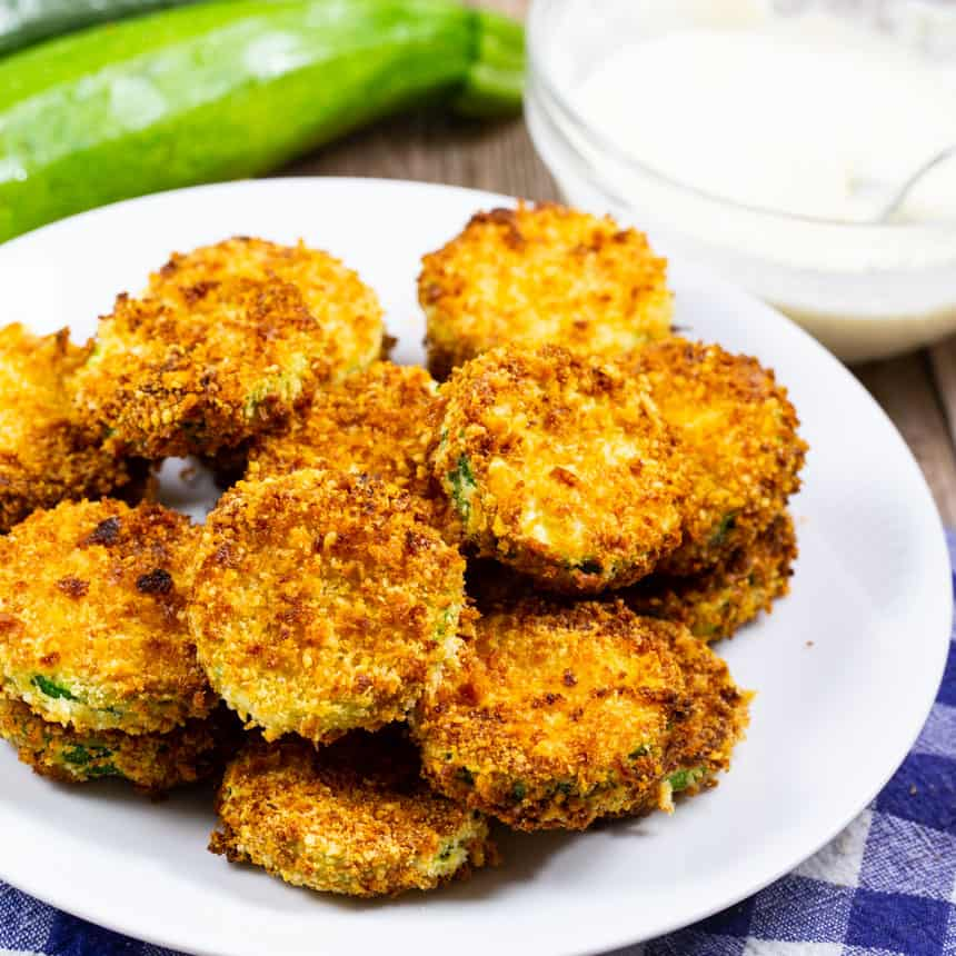 Zucchini Chips on a white plate.
