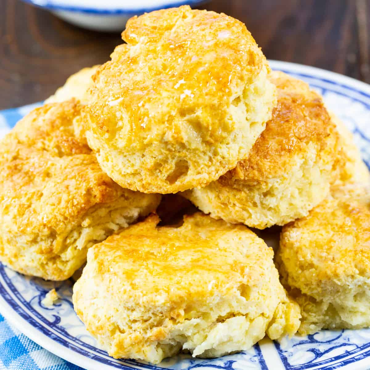 Air Fryer Buttermilk Biscuits stacked on a plate.