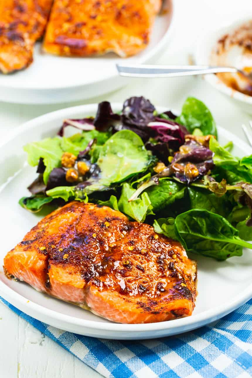 Salmon on a plate with salad.