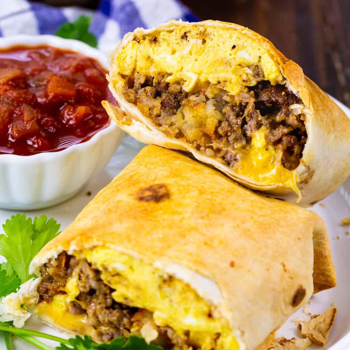 Air Fryer Breakfast Burrito with Sausage cut in half.