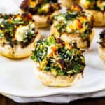 Air Fryer Spinach and Feta Stuffed Mushrooms on a plate.