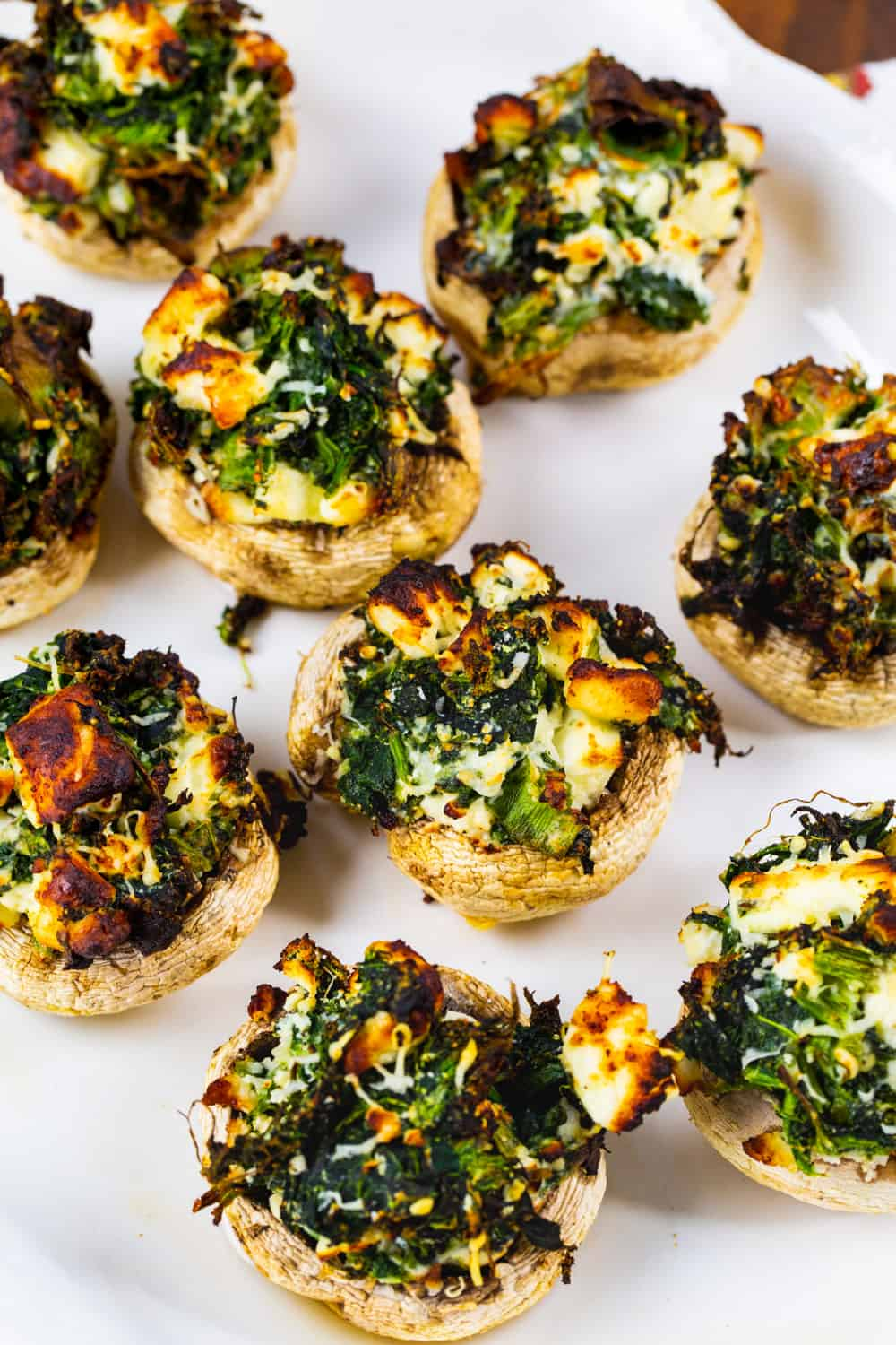 Air Fryer Spinach and Feta Stuffed Mushrooms on a serving plate.