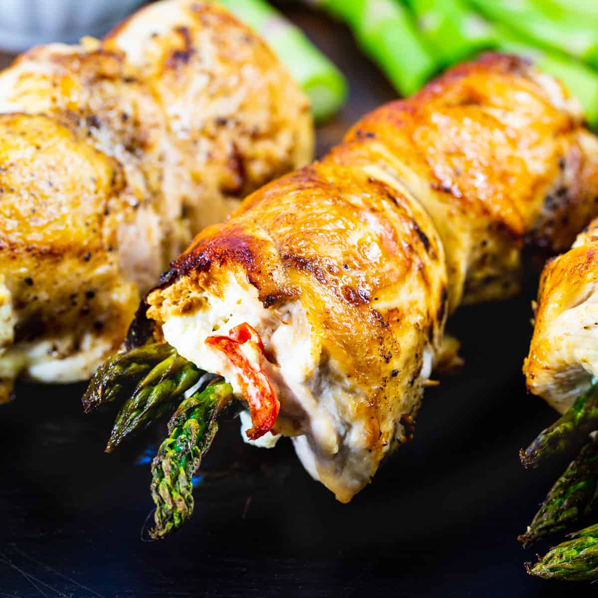 Chicken Asparagus and Goat Cheese Roll-ups on a cutting board.