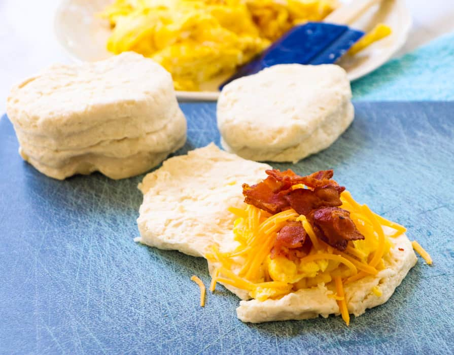 Split apart biscuit and piled up with bacon, egg, and cheese.