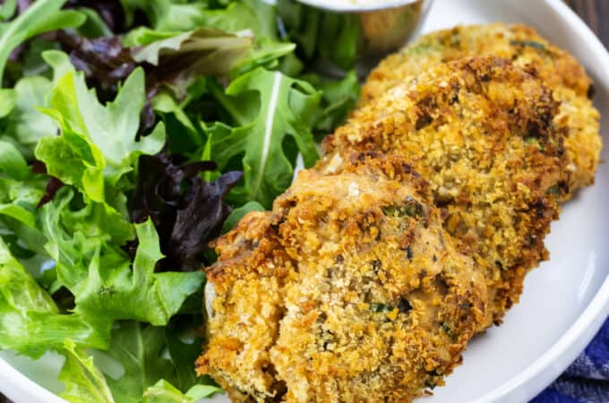 Three Air Fryer Southern Salmon Patties on a plate with salad.