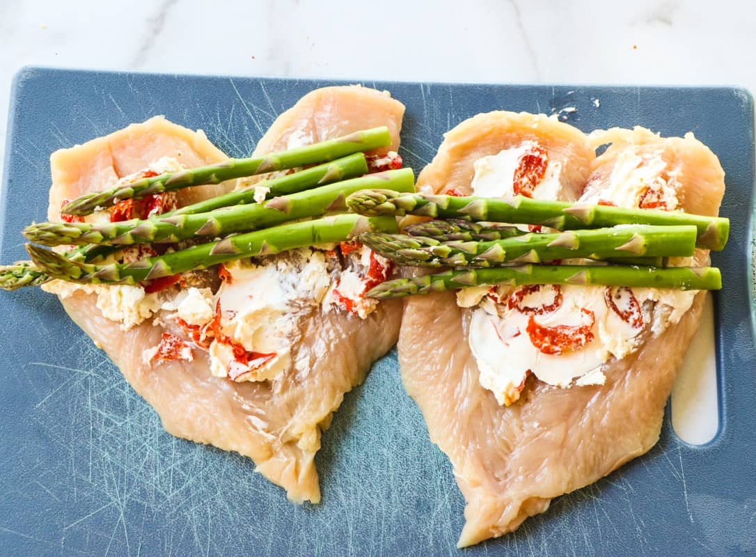 Goat cheese mixture spread on chicken breasts.