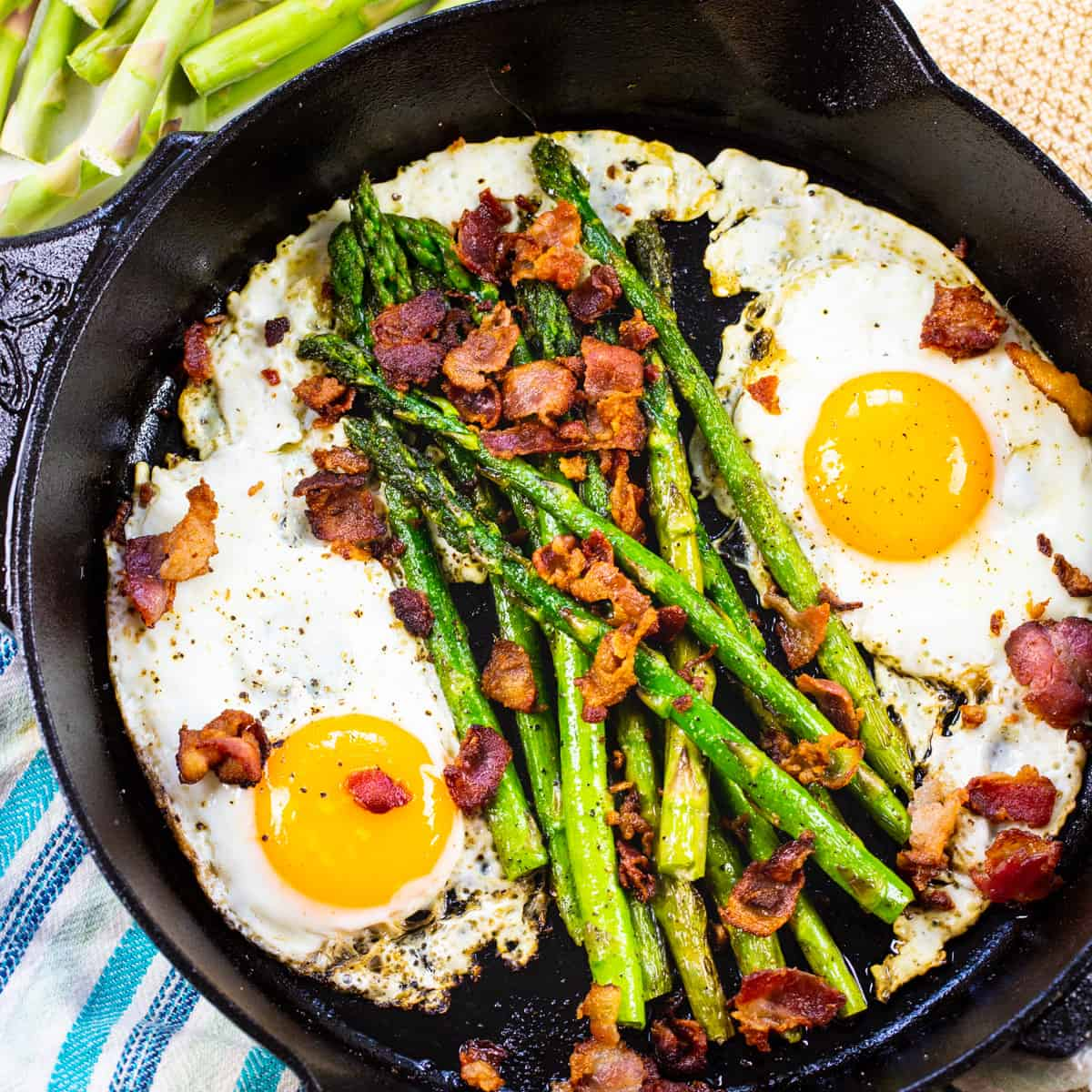 One Pan Bacon, Asparagus, and Egg Breakfast in a cast iron pan.