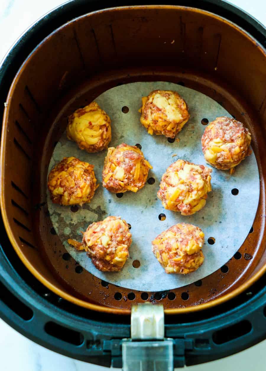 Uncooked Sausage Balls in air fryer.