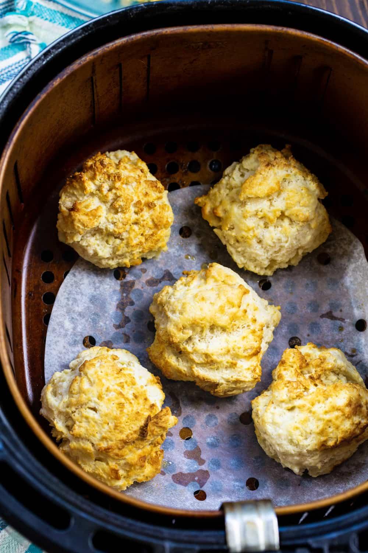 Air Fryer Buttermilk Drop Biscuits in air fryer basket.